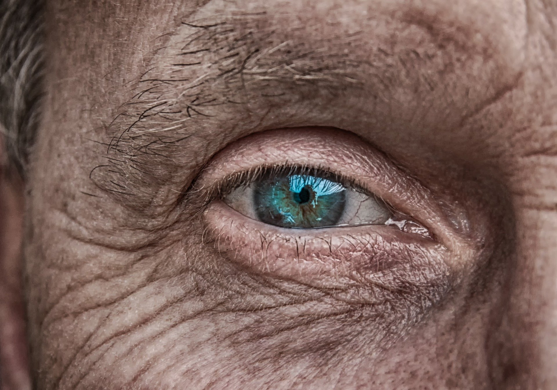 A close up on the eye of an older man