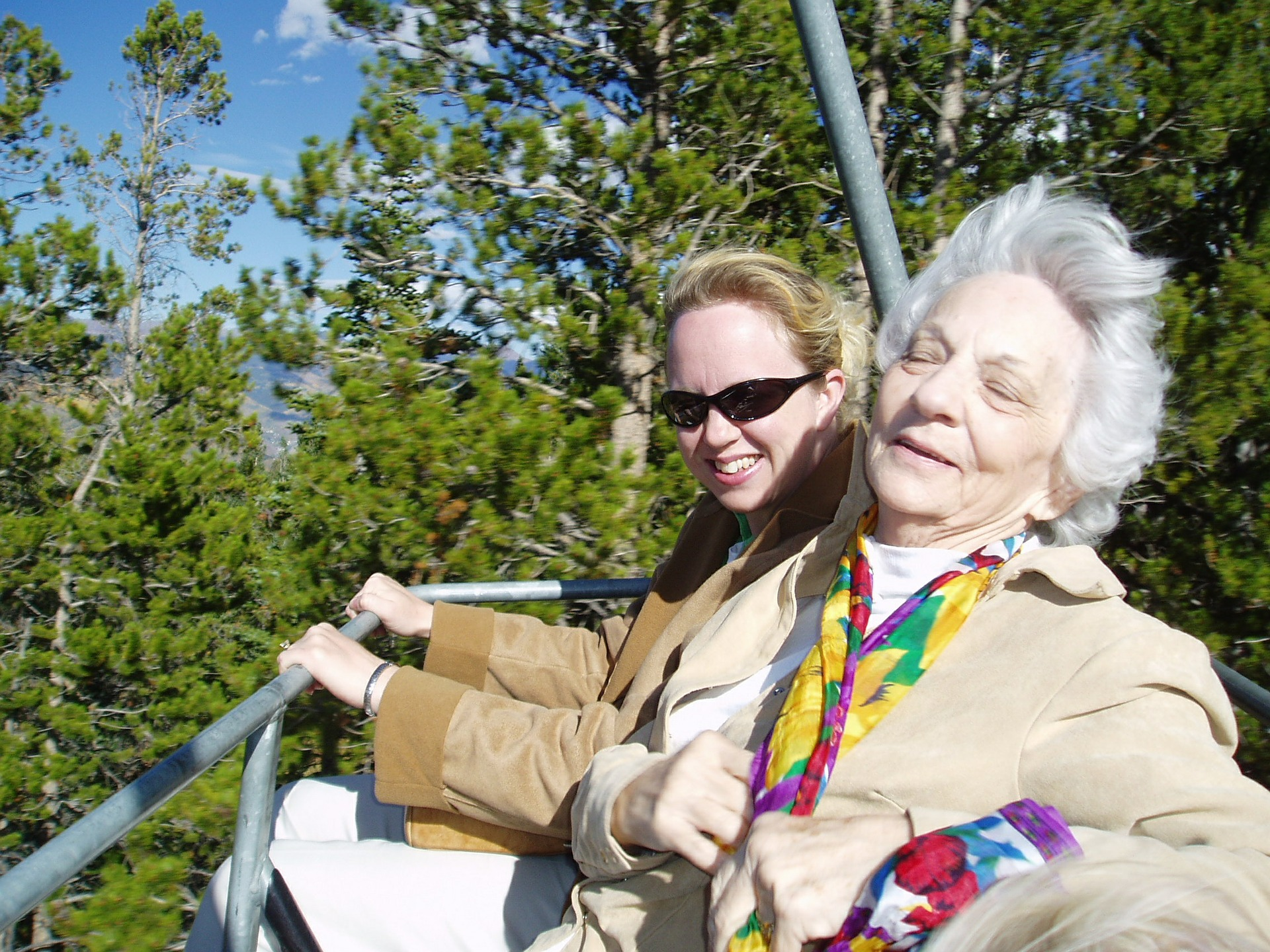 older woman on a ride with her family caregiver